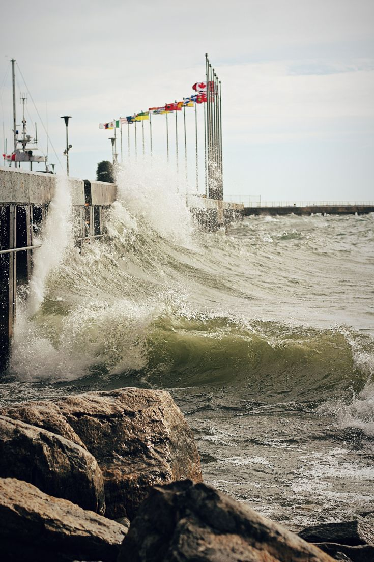 waves splashing on harbour wall kingston ontario