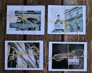 Sets of Kingston themed photography postcards, with envelopes, tied with a string.