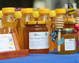 Jars of honey with yellow caps at Kingston's Memorial Centre Farmer's Market