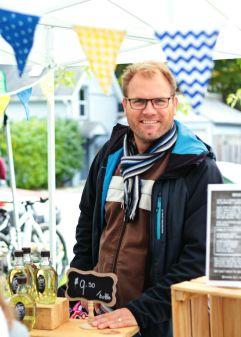 A Swedish vendor at Kingston's Memorial Centre Farmer's Market in his market stall. Drink Saft.