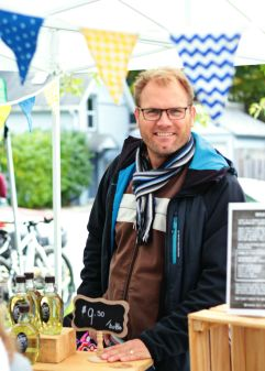 A Swedish vendor at Kingston's Memorial Centre Farmer's Market in his market stall. Drink Saft.