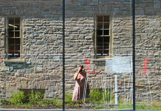 A selfie of the photographer, the facade of The Tett and The Isabel in Kingston, ONtario, Canada.