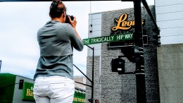 Trying to capture the best shot possible of the Tragically Hip street sign at the Leon's Centre in Kingston, Ontario, Canada.